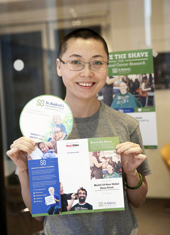 Shavee in Hong Kong holds St. Baldrick's brochure