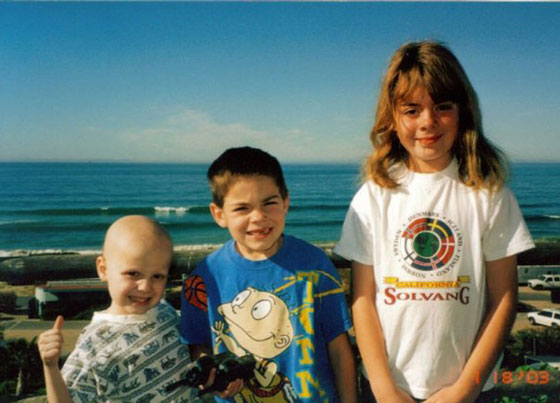 Young Nina poses with her younger brothers, William and Thomas