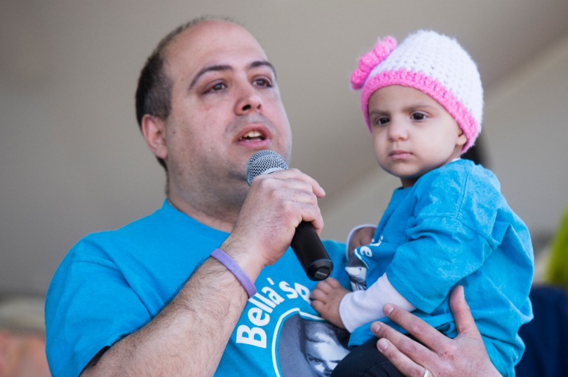 Isabella with her dad at a St. Baldrick's event
