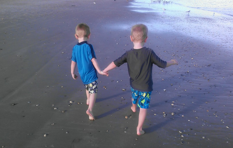 Will and Benjamin walk on the beach
