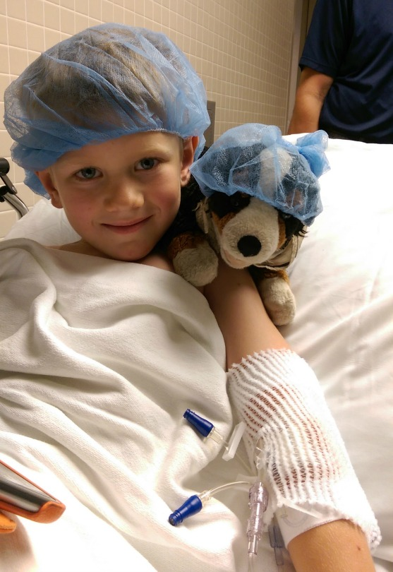 Will holds his stuffed dog, Harley, before going into surgery