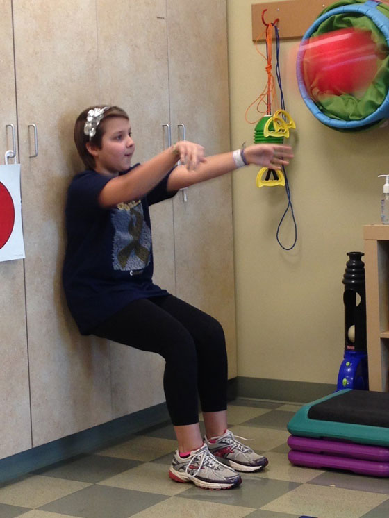 Alyssa in physical therapy