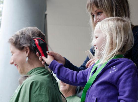Aurora helps shave Katrina's hair at UC Santa Cruz