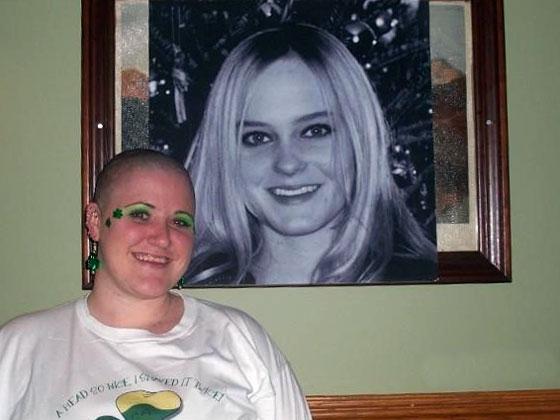 some April smiles next to photo of Kristy