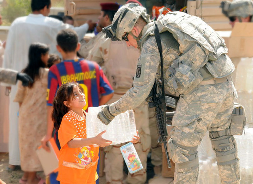 Johnny interacts with a smiling young girl during one of his deployments