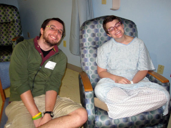 Sarah and Patrick sitting and smiling