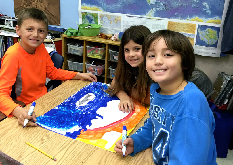 three students create fundraising poster