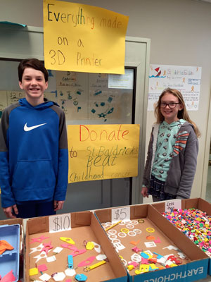 two students sell items to raise money