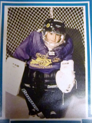 Johnny as a young kid in a hockey uniform