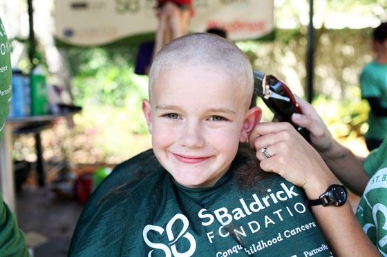 Bald boy smiling