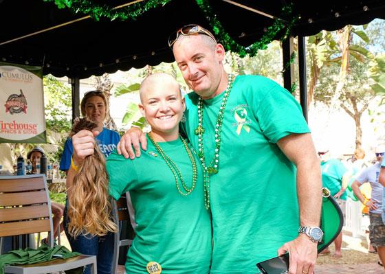 Bald girl holding hair