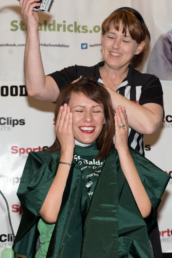 Keli shaves another St. Baldrick's supporter's head