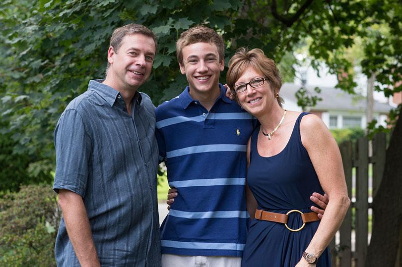 Ambassador Aaron smiles with his parents, Dana and Greg