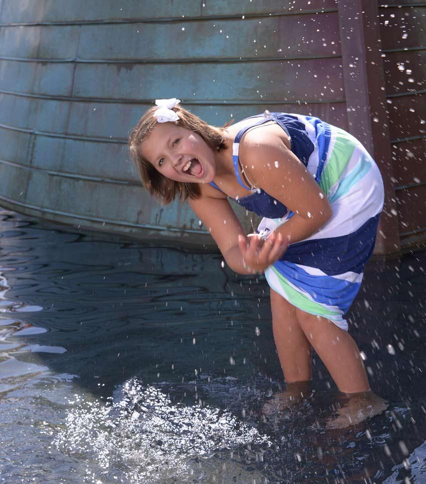 Alyssa splashing in some water