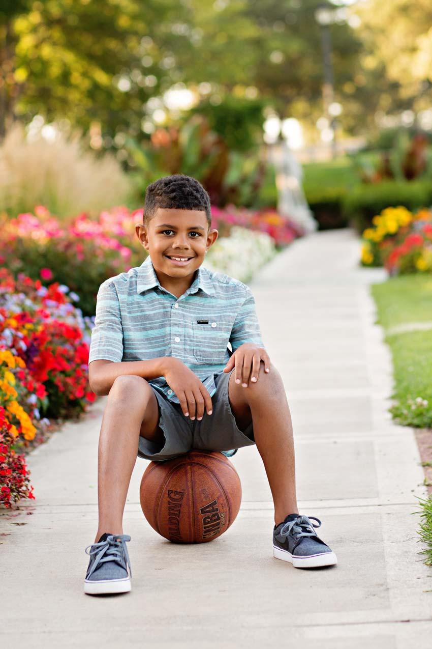 Isaac sits on his basketball
