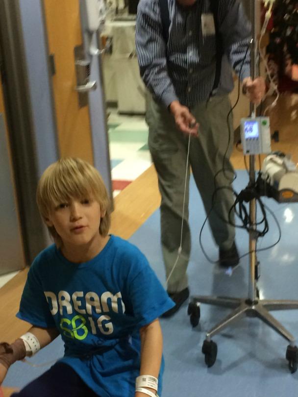 Alex rides his bike around the hospital