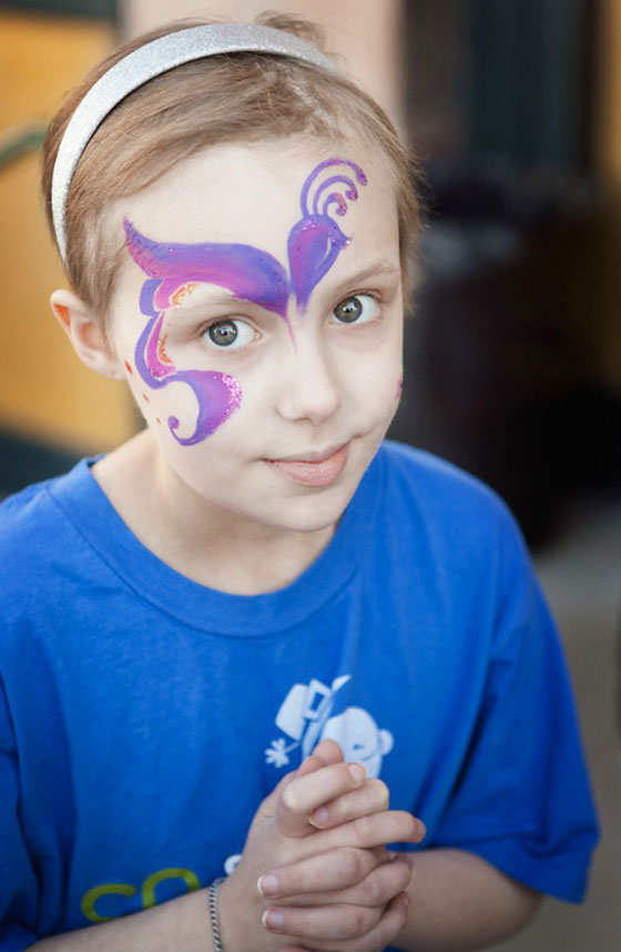 Avery with face paint at a St. Baldrick's event