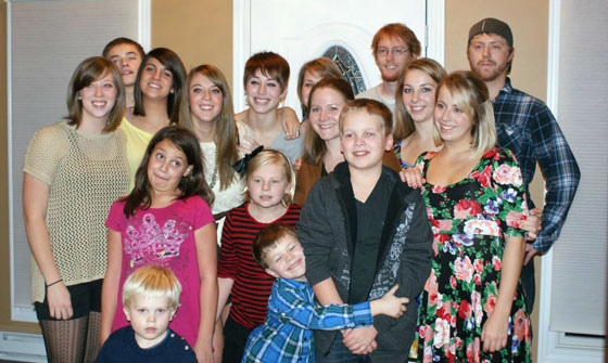 The cousin clan takes a group photo