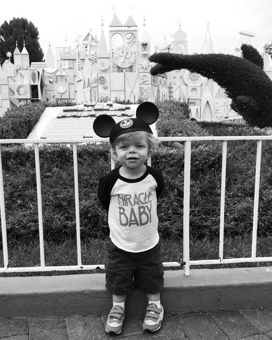 Ezra in front of the Disneyland castle