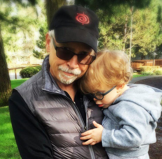 Gary holds Ezra in the park