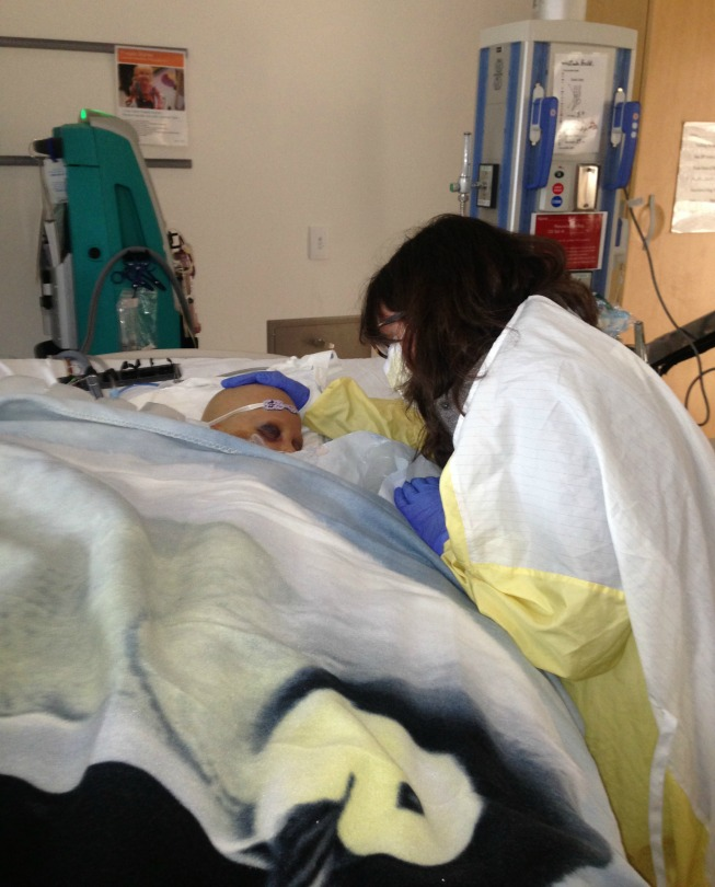 Dr. Jessica Pollard at the bedside of one of her patients