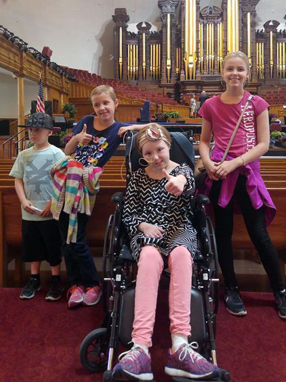 Avery and her siblings at a Mormon temple