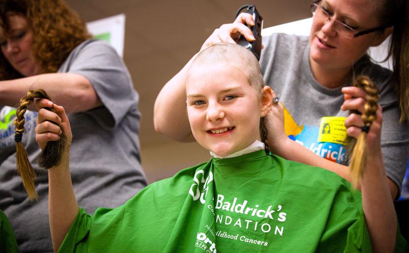 Shavee girl holding her braid