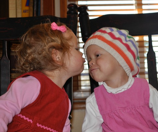 Tuesday and her twin, Piper, share a kiss