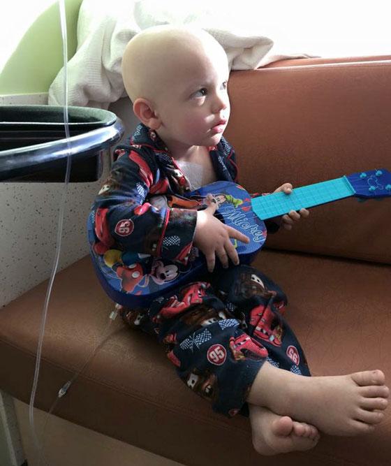 Aiden playing his ukulele