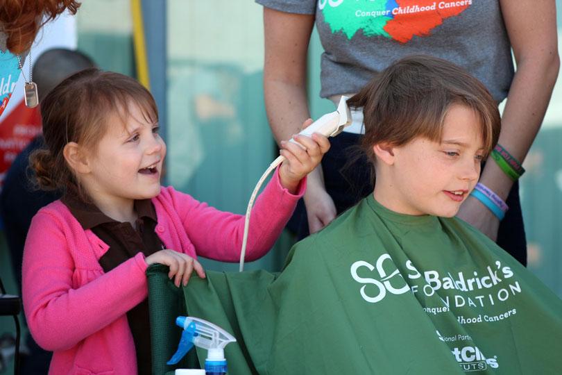 Hazel shaving Micah's head
