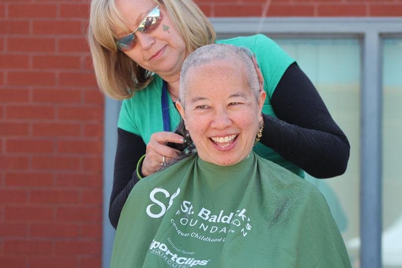 Bald woman shavee