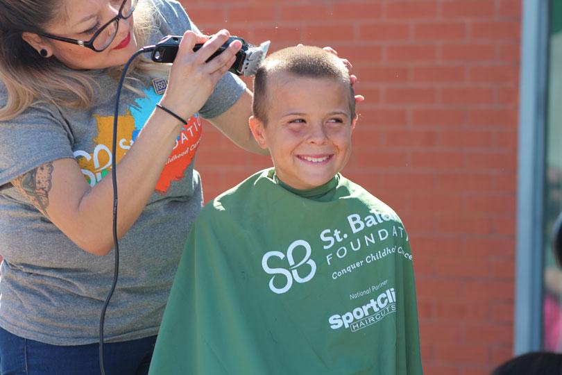 Bald kid shavee