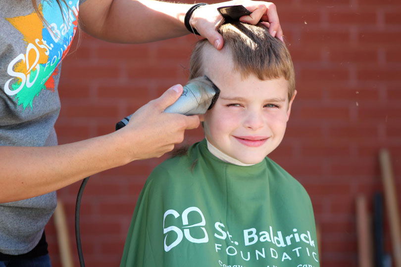 Young boy getting his head shaved