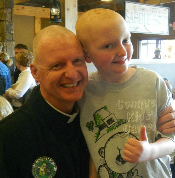 Ian smiles and gives a thumbs up with his friend Father Morgan after their shave