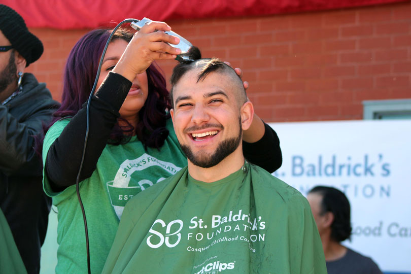 Jonathan Miranda with his head half shaved