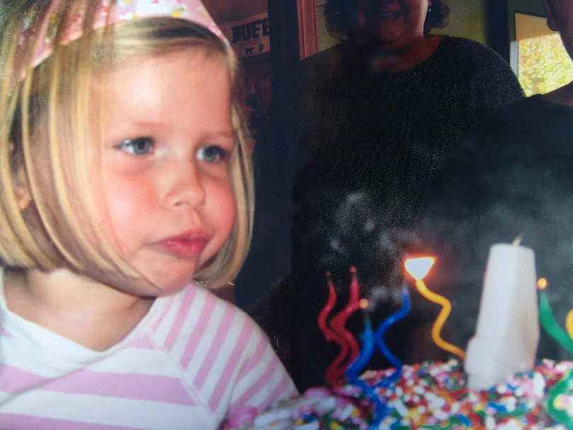 Sara blowing out birthday candles days before her Wilms tumor diagnosis