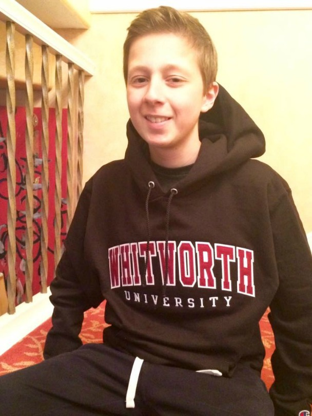 Mitch wears college sweatshirt
