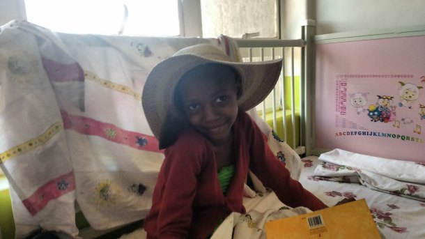 Shakina, one of Dr. Lubega's patients with kidney cancer, smiles for the camera
