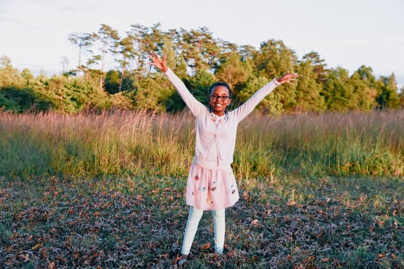 Julia stands in a field