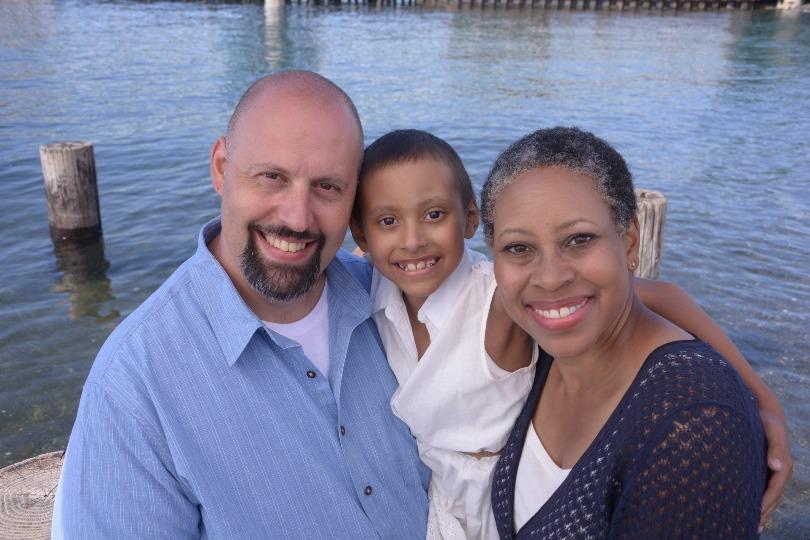 Maya with her parents
