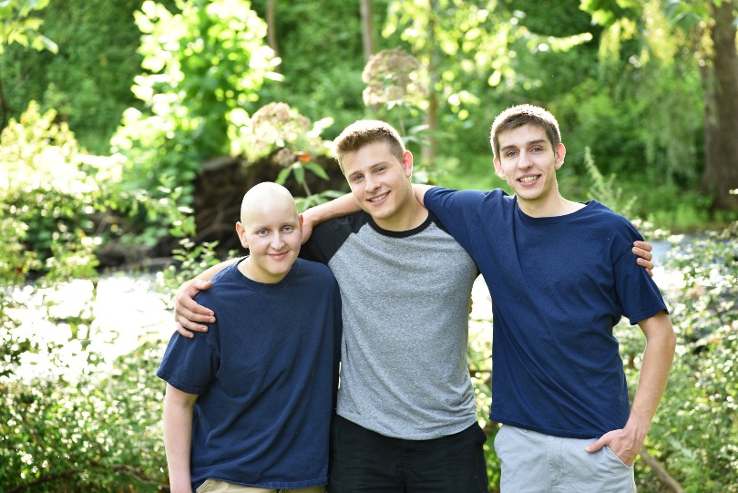 Zach with his brothers