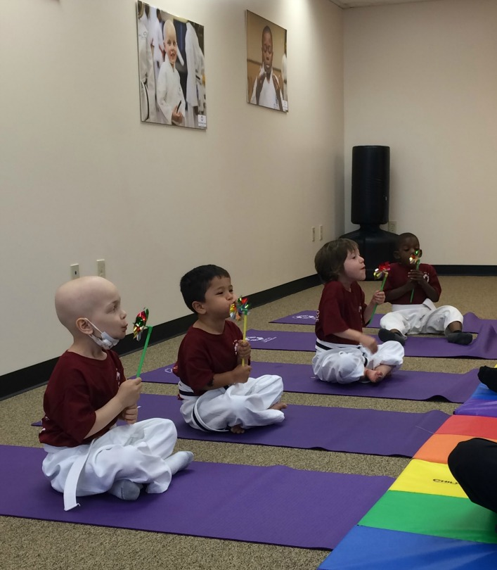 Kids with cancer do a breathing exercise