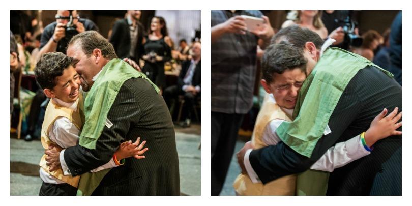 Zein's dad hugs his son