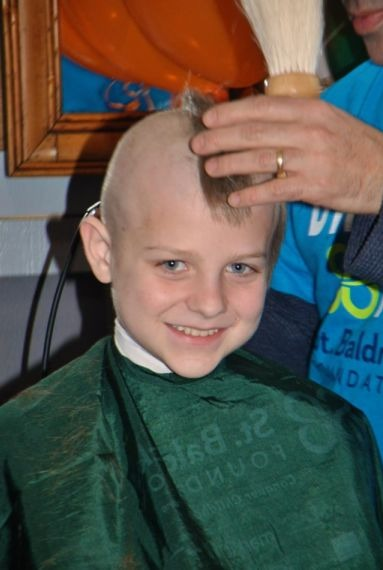 Christian shaves his head