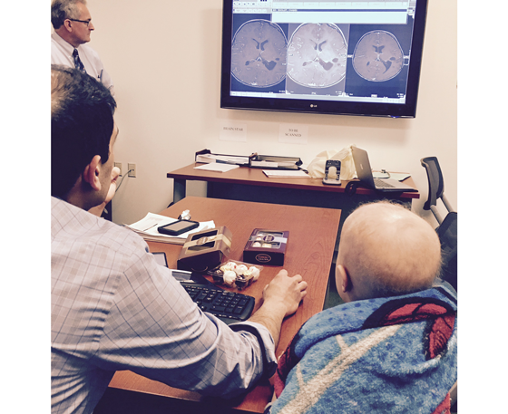 Chase and Dr. Lulla look at brain scans