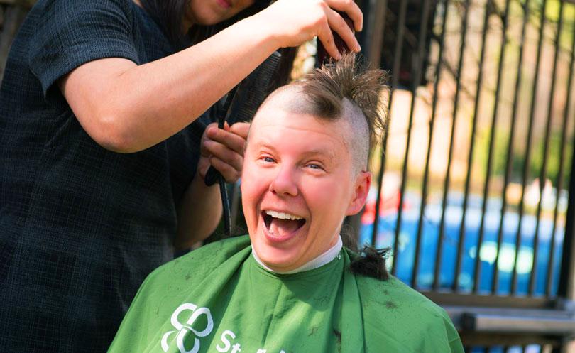 head-shaving-event-registration-2017-header-woman-shavee-smiling.jpg
