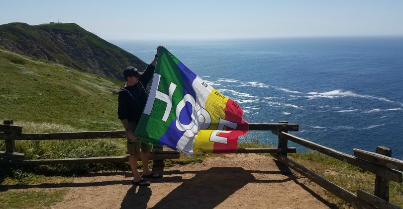 Sean holding the flag of hope.