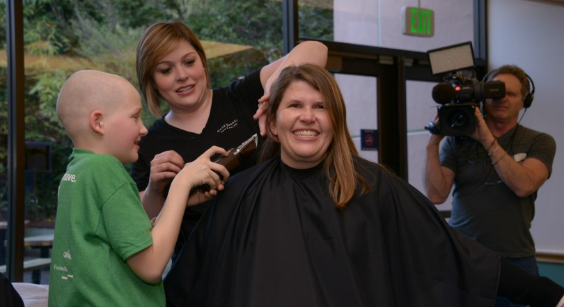 Kelly getting her head shaved by her son