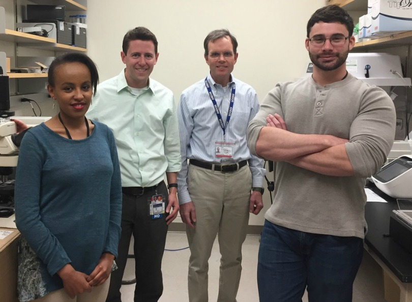 Dr. Adam Green in the lab with his colleagues