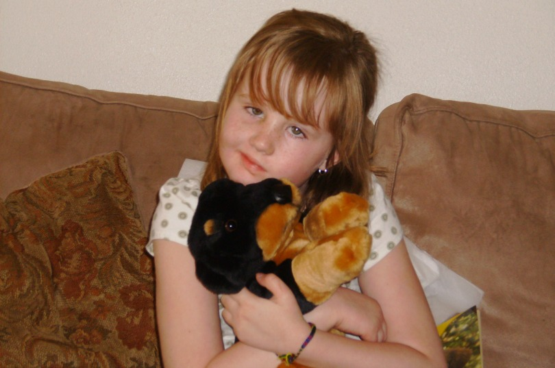 Kylee hugs a stuffed animal